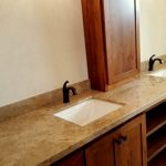 Granite counters and backsplash with dual undermount sinks