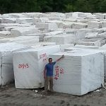 Granite blocks ready to be cut at the quarry. Hand selecting granite for a customer